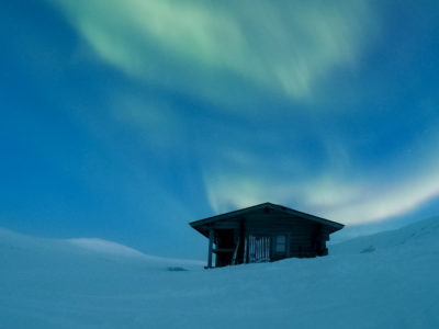 Northern Lights above a wilderness cabin