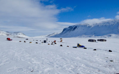 Sled dog camp by a fell