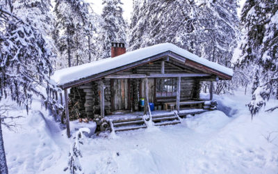 Wilderness cabin covered in snow